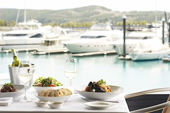 Hamilton Island honeymoon - enjoy a meal on the water at Romano's